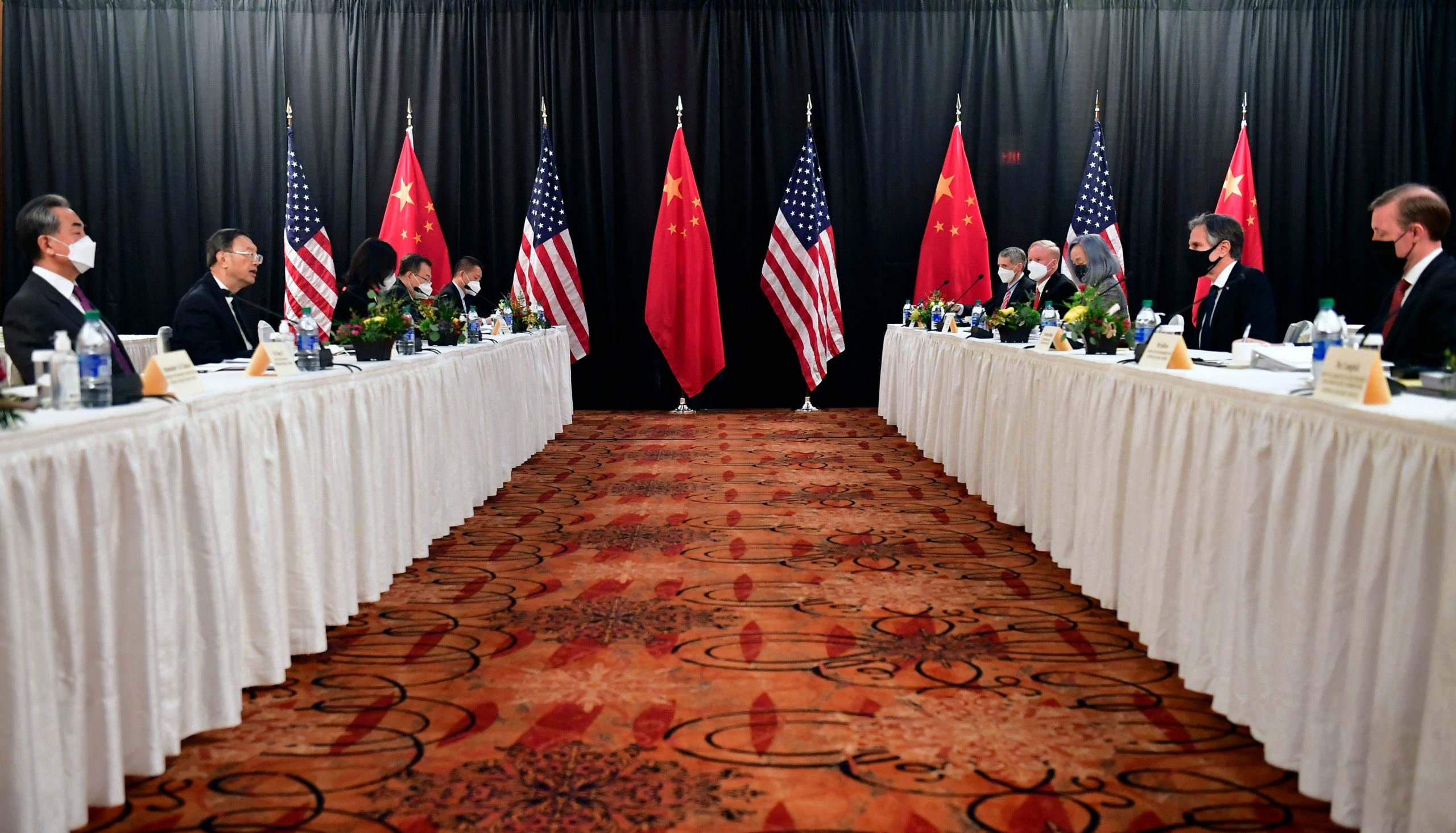 Secretary of State Antony Blinken, joined by National Security Adviser Jake Sullivan, speaks while facing Chinese diplomats in Anchorage, Alaska on March 18. (Frederic J. Brown/Pool/AFP via Getty Images)